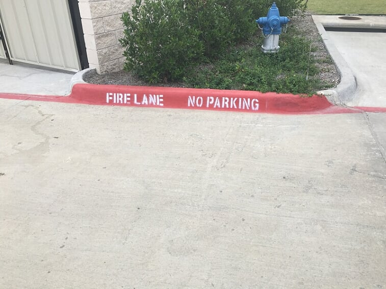 Fire lane striping on your curb in Mobile, Alabama