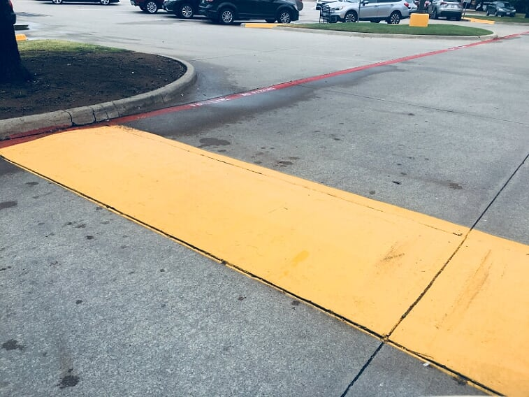 Speed bump painting in your parking lot in Mobile, Alabama